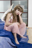 Little cute girl eight years old wearing angel wings — Stock Photo