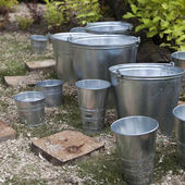 Zinc bucket of water standing — Stock Photo