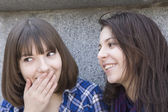 Two girls talk near wall of stone — Foto Stock