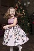 Little girl near Christmas tree — Stock Photo