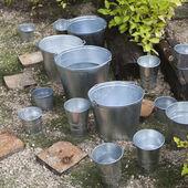 Zinc bucket of water standing — Stock Photo