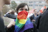 Woman wearing scarf on her face - symbol gey organisation — Stock Photo