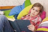 Girl reading in bed — Stock Photo