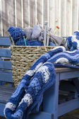 Blue wool and knitting needles — ストック写真