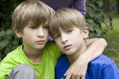 Two smiling twin brothers outdoor portrait — Stock Photo