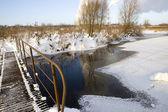 Abandon bridge across river — Stock Photo