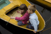 Children in boat — Stock Photo
