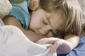 Little girl sleeping in the bed — Stock Photo