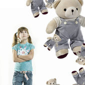 Little girl with teddy-bears — Stock Photo