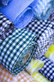 Rolls of fabric in many color — Stock Photo