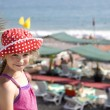 Girl eight years old standing on beach — Stok fotoğraf