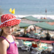 Girl eight years old standing on beach — Стоковое фото