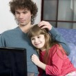 Father and daughter playing game using laptop — Stock Photo #46199351