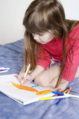 Little cute smiling girl seven years old drawing scetch — Stock Photo