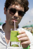 Man in glasses drink cocktail Mojito — Stock Photo