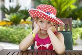 Little cute girl  sitting on restaurant — Stock Photo