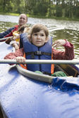 Girl in canoe. Summer time — Stock Photo