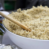 Couscous in faience basin — Stock Photo