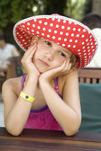 Little cute girl  sitting on restaurant — Stock Photo
