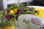 Tulips lying near vintage box — Photo