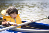 Girl in canoe. Summer time — Stockfoto