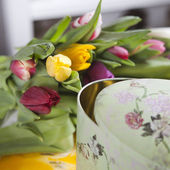 Tulips lying near vintage box — Stock Photo
