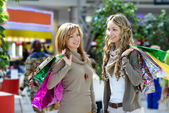 Girls satisfied with purchases talk — Stock Photo