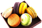 Colorful macaroons isolated in brown box — Stock Photo