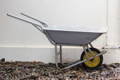 Yellow wheelbarrow — Stock fotografie