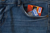 Credit card and jeans — Stock Photo