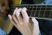 Fingersetting on guitar neck — Stock fotografie