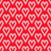 White heart shapes made by triangles seamless pattern on red vec — Stok Vektör