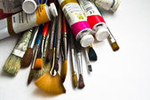 Oil paints and brushes — Stock Photo