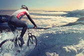 Cyclist in the mountains — Stock Photo