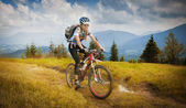 Woman mountain-bike rider — Stock Photo