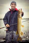 Angler with pike — Stock Photo