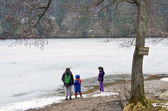Kids playing near a frozen lake — Stock Photo