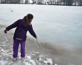 Girl Playing on a Frozen Lake — Stock Photo