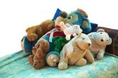 Old stuffed animals on a bed — Stock Photo