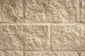 Natural stone brick beige offwhite background — Stock Photo