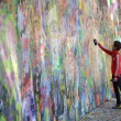 Person adding grafitti to the John Lennon Wall — Stock Photo #44043519