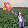 A teenage girl in purple with colorful balloons — Stock Photo #44046191