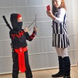 Purim (Halloween): siblings dressed up as soccer referee and nin — Stock Photo