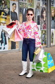Teenage girl on a shopping spree — Stock Photo