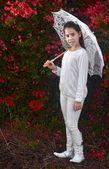 Girl with white umbrella — Стоковое фото