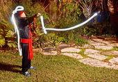 Ninja met een lightsaber — Stockfoto
