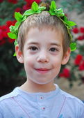 Young boy with a crown of leaves — Foto Stock