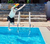 Boy jumping into the Pool — Stock Photo