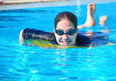 Young woman girl in the pool — Foto Stock