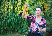 Grandma playing with soap bubbles — Stock Photo